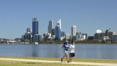 Exercising along the Swan River in Perth, Australia Stock Footage