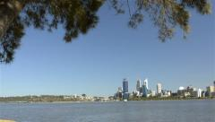 Tracking reveal of Perth City across the Swan River Stock Footage