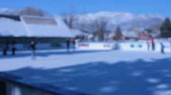 Out of focus ice skaters and rink Stock Footage