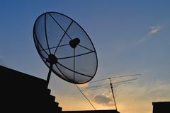 Satellite dish and antenna tv on sunset time Stock Photos