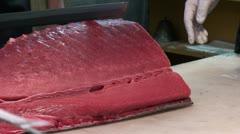 Cutting tuna at Tsukiji fish market in Tokyo, Japan - stock footage