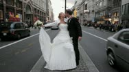 Just married couple kissing in the middle of Strand street, London Stock Footage
