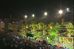 Carnival in Rio, Carnaval, Samba Parades, elaborate electric castle float wide Stock Footage