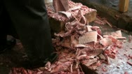 Stock Video Footage of Cutting tuna with an axe, leftovers fall at ground, at Tsukiji, Tokyo