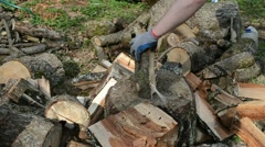 Hands with gloves chopping firewood with axe. prepare wood fuel Stock Footage