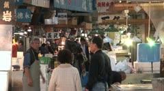 Customers and traders at the Tsukiji fish market in Tokyo, Japan Stock Footage