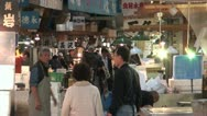 Stock Video Footage of Customers and traders at the Tsukiji fish market in Tokyo, Japan