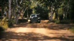 Cadillac 1956 Driving On Country Road-Vintage 8mm film Stock Footage