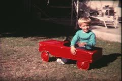 1960's archive-child and pedal car Stock Footage
