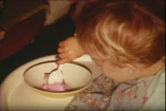 1960's archive-toddler eats ice cream Stock Footage
