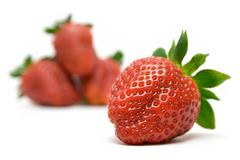 Focused Strawberry Isolated on a White Background - stock photo