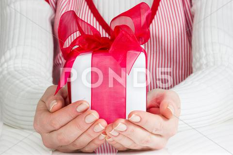 Stock photo of woman showing  gift