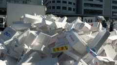 Fork lift gathers foam boxes for recycling at the Tsukiji fish market in Japan - stock footage