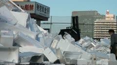 Foam boxes and fork lift at Tsukiji fish market - stock footage