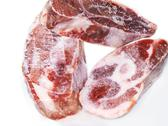 Stock Photo of frozen raw meat, three pieces
