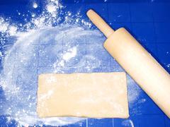 dough on blue silicon mat - stock photo