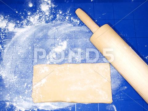 Stock photo of dough on blue silicon mat