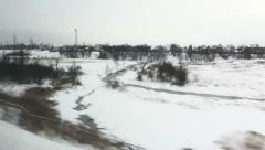 View from window of high-speed train Sapsan at the village, Russia Stock Footage