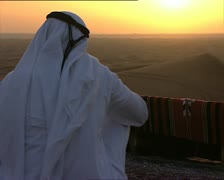 DESERT and arabian watching the sunset Stock Footage