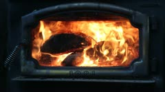 Fire through glass in a wood stove Stock Footage
