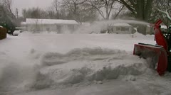 Clearing driveway with a walk-behind snowblower  Stock Footage