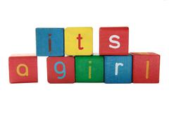 girl announcement blocks - stock photo