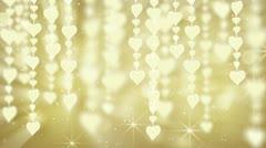 Dangling gold hearts loop Stock Footage