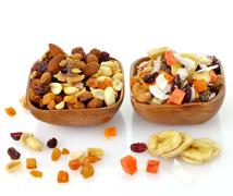 mixed dried fruit, nuts and seeds - stock photo