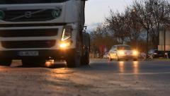 Running dump trucks and heavy traffic noise at busy city Stock Footage