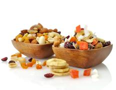 Mixed dried fruit, nuts and seeds Stock Photos