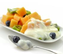 closeup of fruits with yogurt - stock photo