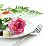 rose and candy on a plate - stock photo