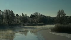 Frosty winter trees, vapor from a river - stock footage