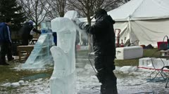 Ice sculptor at work with power tools - Time Lapsed Stock Footage