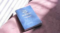 Reading a Book of Mormon Stock Footage