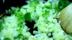 Frying  onions with green pepper Stock Footage
