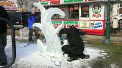 Ice sculptor at work with power tools Stock Footage