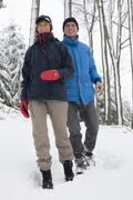 Mature couple walking in the snow Stock Photos