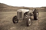 Stock Photo of retro tractor on the iceland field