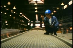 Restoring streamline railroad car, St. Charles yard, Montreal, man atop Stock Footage