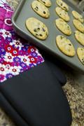 Cookies and cooking mitt Stock Photos