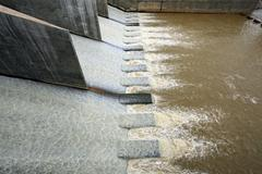 water from dam - stock photo