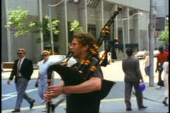 Toronto, 1990, bagpiper playing on Yonge Street Stock Footage