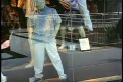 Toronto, 1990, Eaton Center, mannequin in window, crowd passes Stock Footage