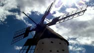 Old windmill in a spanish countryside with blue sky - timelapse Stock Footage