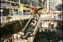Toronto, 1990, Eaton Center, escalator going up, wide, busy shot Stock Footage