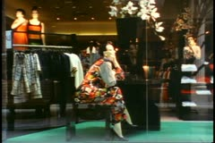 Toronto, 1990, Eaton Center, mannequin in window, zoom in, crowds Stock Footage
