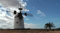 Old windmill in a spanish countryside with blue sky - timelapse - stock footage
