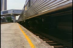 """""""The Canadian"""" train departs Union Station, Toronto, low shot of wheels Stock Footage"""