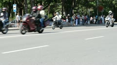 Biker ride motorcycles in birzai and people watch Stock Footage